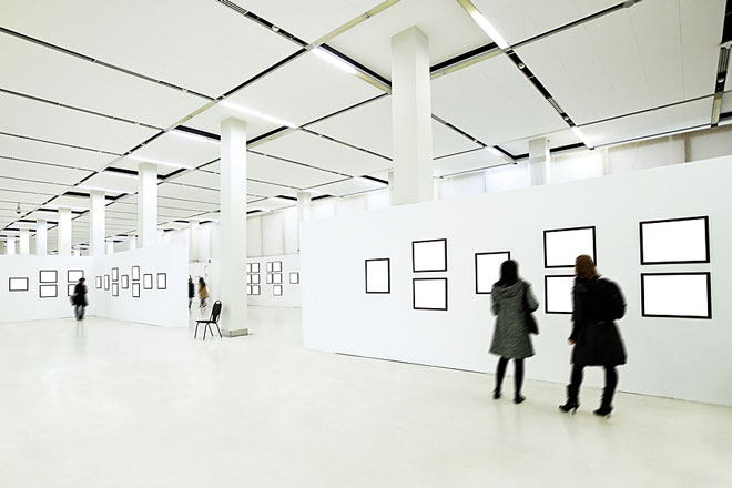 art enthusiasts viewing paintings in an art gallery