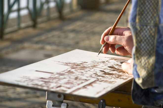 watercolor artist painting while traveling