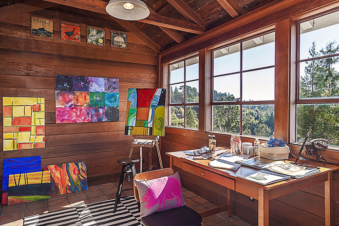 rustic artist studio with art furniture and paintings
