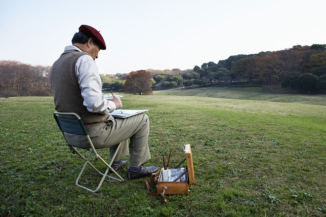 plein air artist with tote box