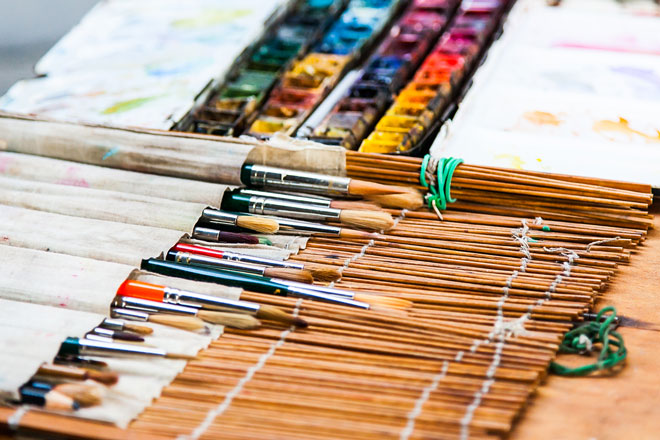 watercolor paintbrushes in an art brush holder