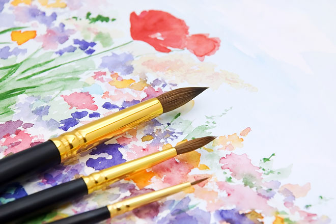 watercolor painting and paintbrushes