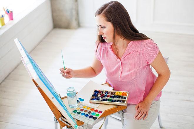 watercolor artist at work in her studio